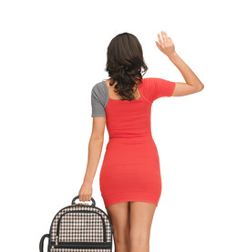 woman with suitcase waving hand
